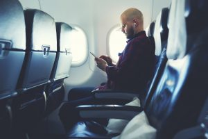 Five Ways Location Based Data Benefits: Travel and Transportation - Man on Plane Image