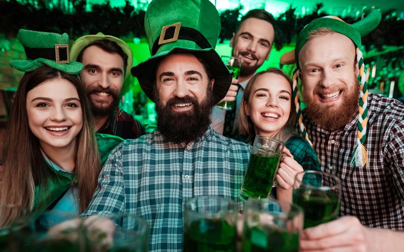 A group of friends celebrate St. Patrick's Day at an event.
